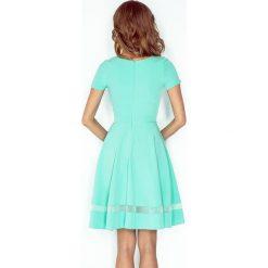 Giulia Sukienka midi z tiulowymi pasami - MIĘTOWA. Zielone sukienki na komunię marki morimia, s, w paski, z tiulu, midi. Za 189,99 zł.
