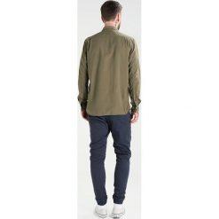Nudie Jeans HENRY Koszula bunker. Brązowe koszule męskie jeansowe marki Nudie Jeans, m. Za 419,00 zł.
