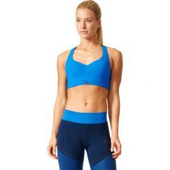 Topy sportowe damskie: Adidas Biustonosz Committed Chill niebieski r. M (BK3108)
