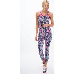 Legginsy we wzory: Kolorowe legginsy sportowe w geometryczne kształty / mięta H0010