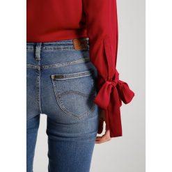 Lee ELLY Jeans Skinny Fit destroyed denim. Szare jeansy damskie marki Lee, z bawełny. W wyprzedaży za 157,05 zł.