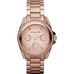 """Zegarek kwarcowy """"Blair"""" w kolorze różowozłotym. Żółte, analogowe zegarki damskie marki Michael Kors, ze stali. W wyprzedaży za 560,95 zł."""