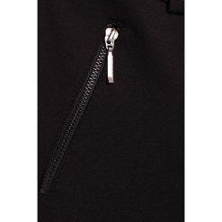 Sly - Spodnie dziecięce 128-164 cm. Czarne rurki dziewczęce SLY, z bawełny. W wyprzedaży za 119,90 zł.