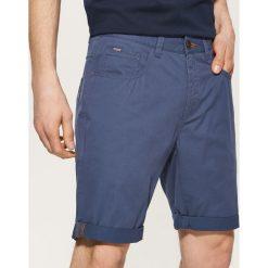 Materiałowe szorty - Niebieski. Niebieskie spodenki i szorty męskie marki House, z materiału. W wyprzedaży za 49,99 zł.