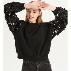Bluza z błyszczącymi cekinami - Czarny. Czarne bluzy damskie Sinsay, l. Za 79,99 zł.