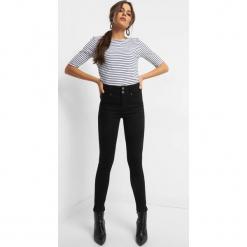 Jegginsy z wysokim stanem. Czarne legginsy marki Orsay, xs, z bawełny, z dekoltem na plecach. Za 89,99 zł.