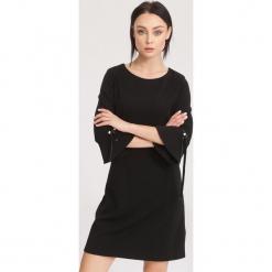 Czarna Sukienka Radiant. Sukienki małe czarne marki other, l. Za 69,99 zł.