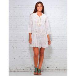 Sukienki hiszpanki: Sukienka w kolorze białym