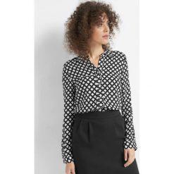Koszula z drobnym wzorem. Brązowe koszule wiązane damskie Orsay, w kolorowe wzory, z tkaniny. Za 69,99 zł.