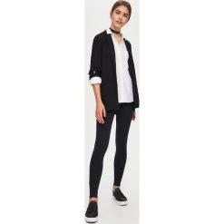 Bawełniane legginsy - Czarny. Białe legginsy marki Sinsay, l, z napisami. Za 19,99 zł.