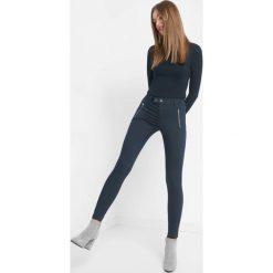 Jeansy skinny z zamkami. Czarne jeansy damskie marki Orsay, xs, z bawełny, z dekoltem na plecach. Za 119,99 zł.