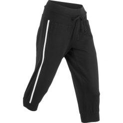 Spodnie sportowe 3/4, Level 1 bonprix czarny. Czarne spodnie sportowe damskie marki KIPSTA, l, z bawełny, na fitness i siłownię. Za 59,99 zł.
