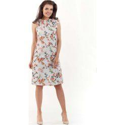 Odzież damska: Ecru Kobieca Sukienka w Kwiatowy Wzór Kokardą na Ramieniu