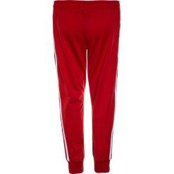 Adidas Originals PANTS Spodnie treningowe scarlet. Czerwone spodnie chłopięce marki adidas Originals, z bawełny. Za 169,00 zł.