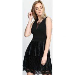 Czarna Sukienka One Last Time. Czarne sukienki marki Mohito, l, z dekoltem na plecach. Za 109,99 zł.