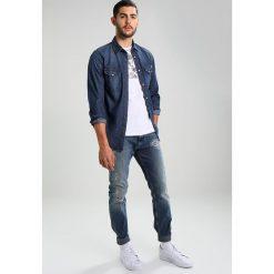 Calvin Klein Jeans ORIO Jeansy Slim fit orion blue. Niebieskie jeansy męskie relaxed fit marki Calvin Klein Jeans. W wyprzedaży za 535,20 zł.
