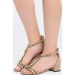 Beżowe Sandały Shrewdness. Brązowe sandały damskie Born2be, z materiału, na wysokim obcasie, na obcasie. Za 69,99 zł.