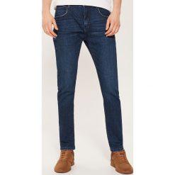 Jeansy slim - Granatowy. Niebieskie jeansy męskie regular House. Za 99,99 zł.