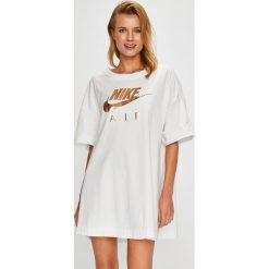 Nike Sportswear - Top. Szare topy damskie Nike Sportswear, m, z nadrukiem, z bawełny, z okrągłym kołnierzem. Za 159,90 zł.