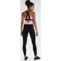 Puma SHINY Top violet tulle. Czerwone topy sportowe damskie marki Puma, m, z elastanu. W wyprzedaży za 126,75 zł.