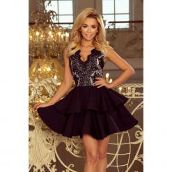 200-3 charlotte - ekskluzywna sukienka z koronkowym dekoltem - czarna. Czarne sukienki koronkowe marki numoco, l, w koronkowe wzory, rozkloszowane. W wyprzedaży za 249,00 zł.