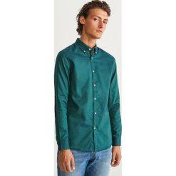 Koszula z bawełny oxford slim fit - Turkusowy. Niebieskie koszule męskie slim Reserved, m, z bawełny. Za 99,99 zł.