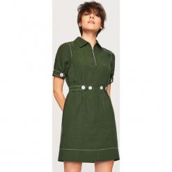 Sukienka z domieszką lnu - Khaki. Brązowe sukienki z falbanami marki Reserved. W wyprzedaży za 79,99 zł.