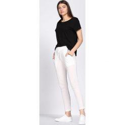 Białe Spodnie Dresowe Tranquility. Czarne spodnie dresowe damskie marki Born2be, l. Za 29,99 zł.