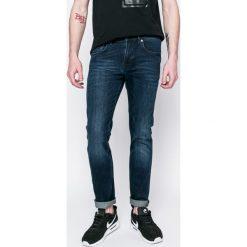 Lacoste - Jeansy. Niebieskie jeansy męskie regular Lacoste, z aplikacjami, z bawełny. W wyprzedaży za 369,90 zł.