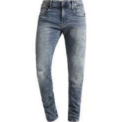 GStar REVEND Jeans Skinny Fit vintage aged destroyed. Niebieskie rurki męskie marki G-Star, z bawełny. Za 609,00 zł.