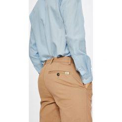 Lacoste - Spodnie. Szare chinosy męskie marki Lacoste, z bawełny. W wyprzedaży za 299,90 zł.