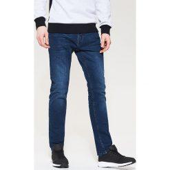 Jeansy regular classic - Granatowy. Czarne jeansy męskie regular marki KIPSTA, z poliesteru, do piłki nożnej. Za 99,99 zł.