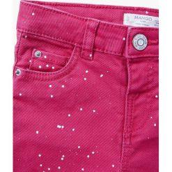 Mango Kids - Jeansy dziecięce Pintora 80-104 cm. Różowe jeansy dziewczęce Mango Kids, z aplikacjami, z bawełny. W wyprzedaży za 29,90 zł.
