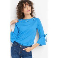 Koszulka z aplikacją 3D. Niebieskie t-shirty damskie Orsay, xs, z aplikacjami, z dzianiny. W wyprzedaży za 55,00 zł.