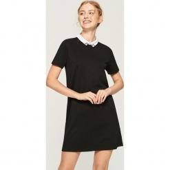 Sukienka z kołnierzykiem - Czarny. Czarne sukienki z falbanami marki Sinsay, l. Za 59,99 zł.