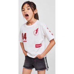 Mango Kids - Top dziecięcy Faster 110-164 cm. Szare bluzki dziewczęce bawełniane Mango Kids, z nadrukiem, z okrągłym kołnierzem, z krótkim rękawem. Za 49,90 zł.