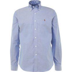 Polo Ralph Lauren Golf Koszula blue. Szare koszule męskie marki Polo Ralph Lauren, l, z bawełny, button down, z długim rękawem. Za 419,00 zł.