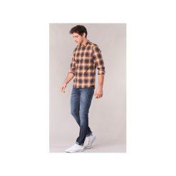 Jeansy slim fit Diesel  THOMMER. Niebieskie jeansy męskie relaxed fit Diesel. Za 527,20 zł.