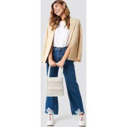 MANGO Jeansy vintage z rozdarciami - Blue. Niebieskie spodnie z wysokim stanem Mango, z jeansu. Za 202,95 zł.