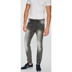 Guess Jeans - Jeansy Chris. Szare jeansy męskie skinny marki Guess Jeans, l, z aplikacjami, z bawełny. W wyprzedaży za 349,90 zł.