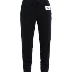 Calvin Klein Jeans PERSIS TRUE ICON TRACK PANT Spodnie treningowe black. Czarne spodnie sportowe damskie Calvin Klein Jeans. W wyprzedaży za 359,20 zł.