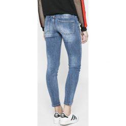 Answear - Jeansy Sporty Fusion. Niebieskie jeansy damskie rurki ANSWEAR, z aplikacjami, z bawełny. W wyprzedaży za 89,90 zł.