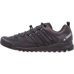 Adidas Performance TERREX SOLO Obuwie hikingowe dark grey/core black/solid grey. Szare buty sportowe męskie adidas Performance, z materiału, outdoorowe. Za 549,00 zł.