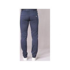 Jeansy slim fit Emporio Armani  TAMWOLE. Szare jeansy męskie relaxed fit marki Emporio Armani, l, z bawełny, z kapturem. Za 543,20 zł.