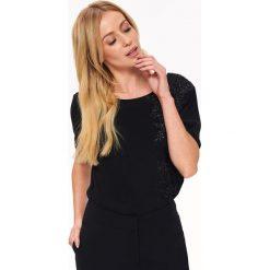 ELEGANCKA BLUZKA Z BŁYSZCZĄCĄ APLIKACJĄ. Czarne bluzki wizytowe Top Secret, z aplikacjami, eleganckie. Za 139,99 zł.