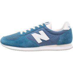 New Balance U220 Tenisówki i Trampki light blue. Niebieskie tenisówki męskie New Balance, z materiału. W wyprzedaży za 237,30 zł.