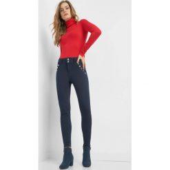 Jegginsy z wysokim stanem. Niebieskie legginsy marki Orsay, s, z bawełny. Za 99,99 zł.