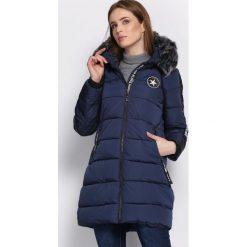 Granatowa Kurtka Discerning. Brązowe kurtki damskie pikowane marki QUECHUA, na zimę, m, z materiału. Za 189,99 zł.