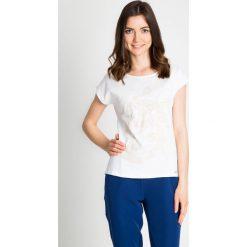 Bluzki asymetryczne: Biała bluzka z cekinami QUIOSQUE