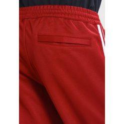 Spodnie męskie: adidas Originals ADICOLOR BECKENBAUER  Spodnie treningowe rust red